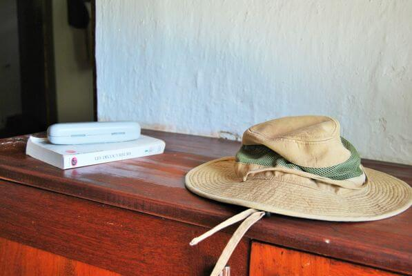 A hat and a book on top of a desk
